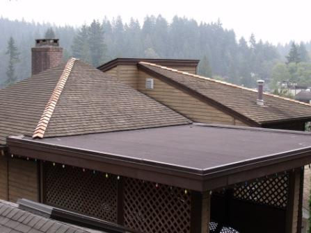 """After"" picture sample of cedar cap replacement done by Above All Roofing."